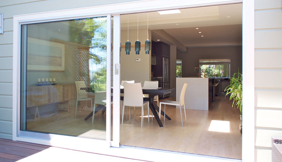 Choosing the right style patio doors for your home for Sliding front door